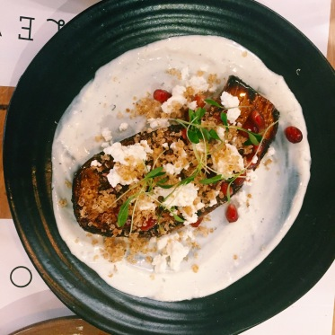 aubergine with quinoa, pomegranate, feta cheese, chilli and lime yoghurt