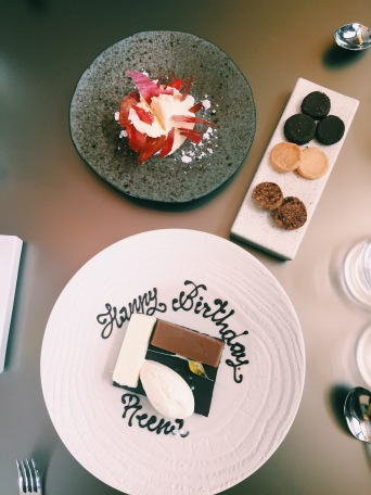 chocolate mondrian birthday dessert, yoghurt and strawberries, selection of biscuits