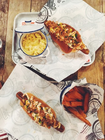 corn guac dog, sweet potato chips, hot dog, bread bun, macaroni cheese