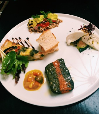 Vegetarian platter including quiche, pate, halloumi, mozerella, bread