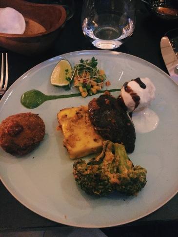 starter selection plate: grilled panner, aloo tikki, broccoli, lentil dumpling
