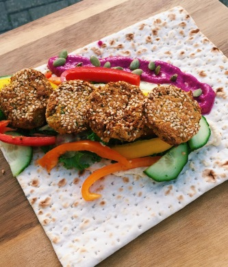falafel wrap with beetroot dip, salad and hummus